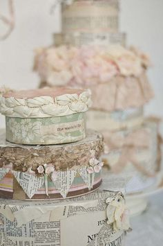 shabby chic paper cakes..my mom made a bunch of fake cakes like these for the centerpiece of each guest table for my wedding..they were beautiful.