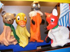 Hand puppet toys representing characters from the East German version of the popular children's television series Sandmännchen, including Schatterinchen, Pittiplatsch, and Herr Fuchs, on display at the DDR Museum, Berlin, Germany, 2013, photograph by Annette for Holiday Check.