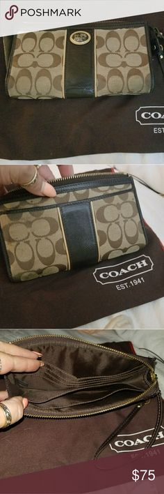 Coach Large Wristlet Wallet Coach Large Authentic Wristlet. I used it as a wallet when I first started purchasing Coach products. Plenty of room for Credit Cards, Cash, Check Book and even touch up make up. Exterior back pockets. All perfectly clean.  Shows wear from use. Leather portiond are all perfect and kept moisturized. If it doesn't go than it's meant to stay. Be Fabulous Coach Bags Clutches & Wristlets