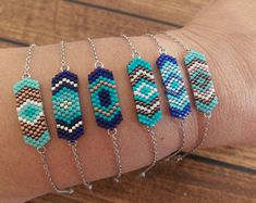 This beadwork bracelet is made with blue and silver Miyuki seed beads.Silver plated chain and parrot clasp are used in this bracelet.The length of this bracelet is 16 blue beadwork bracelet is wonderful gift to yourself or toThey remind me of the sum Beaded Earrings, Beaded Jewelry, Beaded Bracelets, Embroidery Bracelets, Ankle Bracelets, Silver Earrings, Evil Eye Bracelet, Bracelet Set, Friendship Bracelet Patterns