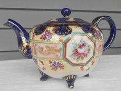 Antique Flow Blue Teapot - Spectacular Old Porcelain - Cobalt Blue with Gold Accents by TollethHouseVintage on Etsy https://www.etsy.com/listing/163826652/antique-flow-blue-teapot-spectacular-old
