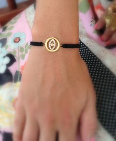 gold and bling evil eye bracelet adjustable black macrame string                                                                                                                                                      More