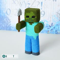"""Zombie with a shovel – is a character of the popular game """"Minecraft"""", that was created by Markus Persson and released by Mojang AB company. Minecraft Crochet Patterns, Minecraft Pattern, Crochet Patterns Amigurumi, Crochet Toys, Minecraft Pillow, Kawaii Crochet, Cute Crochet, Crochet For Kids, Minecraft Beads"""
