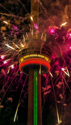 TORONTO. The CN Tower explodes with fireworks during the opening ceremonies of Toronto's Pan Am Games. | by Vik Pahwa Photography