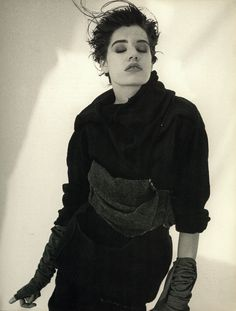 with its ragged look created by patchwork of knitted wool pieces twisted and stitched together, this dress (fall winter 1984) typifies the new aesthetic introduced by rei kawakubo.  photo of claudia © peter lindbergh, courtesy michele filomeco france sarl