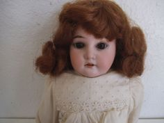 "ANTIQUE GERMAN ARMAND MARSEILLE A.M. DOLL - 3200 DEP FRENCH MKT Marked 3200 M 0 1/2 DEP made in germany.  She is 18"" tall with compo half arms rest of her is cloth"