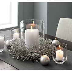 Taylor Glass Hurricane Candle Holders & Crate and Barrel The post Taylor Glass Hurricane Candle Holders Silver Christmas Decorations, Gold Christmas, Simple Christmas, Christmas Wreaths, Coffee Table Christmas Decor, Christmas Centerpieces For Table, Winter Wonderland Centerpieces, Winter Party Decorations, Winter Wedding Centerpieces