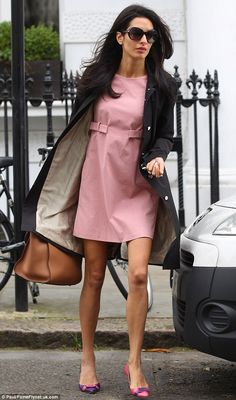 Perfect poise: Amal looked the picture of elegance in her dusty pink dress, mis-matched pink and purple shoes and black mac jacket