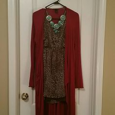 Daytrip leopard shirt/dress It's considered a dress but I wore it more like a shirt.super cute leopard Daytrip top size Large.key hole opening in the back with brown liner under. Perfect for any occasion. Daytrip Tops Tunics