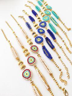 Evil eye bracelet, evil eye charm bracelet, blue seed beads bracelet, gold charm bracelet, evil eye jewelry, zirconia bracelet, elegant #jewellery #bracelet #round #evileye #gold #steel #charmbracelet #blueevileyebead #goldcharmbracelet #evileyes #evileyebracelet #evileyecharm Seed Bead Bracelets, Seed Bead Jewelry, Cute Jewelry, Seed Beads, Beaded Jewelry, Handmade Jewelry, Jewellery Diy, Evil Eye Jewelry, Evil Eye Bracelet