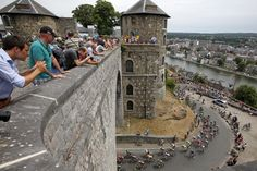 Riders cycle in front of the Citadel of Namur during the 223.5-km (138.9 miles) 4th stage from Seraing in Belgium, to Cambrai, France, July 7, 2015. REUTERS/Eric Gaillard