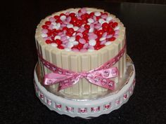 Here is a Valentine version of the Candy Barrel Cake made with white chocolate Kit-Kats and Valentine themed M&Ms.  For instructions see the milk chocolate version on my board.