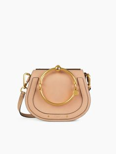 6bba9ae5757d Discover Small Nile Bracelet Bag and shop online on CHLOE Official Website.  in biscotti beige    as seen on Emma Roberts at the Chloé Fall 2017  After-Party ...