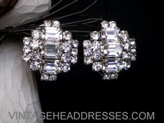 Beautiful large silver vintage diamante earrings, with gorgeous central strip of large emerald-cut stones. These beauties have real impact and sparkle.