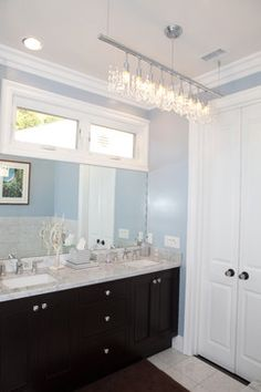 What do you think of chandeliers in the bathroom? Features our Linear Strand Crystal Chandelier. Photo: Globus Builder