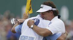 "Phil celebrates win with caddy Jim ""Bones"" Mackay"