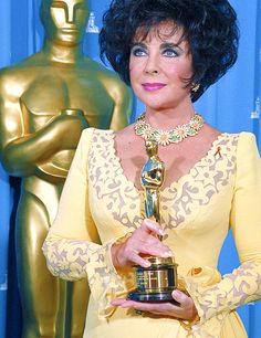 Elizabeth Taylor holding herJean Hersholt Humanitarian Award at the 65th Annual Academy Awards, in 1993