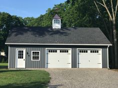 Beautiful on site Woodtex garage with LP board and batton siding, painted dark gray, white trim, and black shingles.