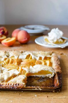 This Fresh Peach Slab Pie takes summer's juciest peaches and makes a HUGE pie complete with the most perfectly crisp, buttery crust flavored with nutmeg. #peachpie #slabpie #piedough #pierecipe