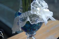 Blues go really well with all aspects of the wedding. Consider even getting a blue garter!