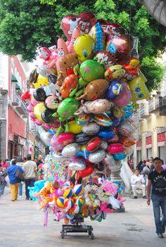 Balloon and toy vendor cart. Puebla, Mexico. by Julee K.