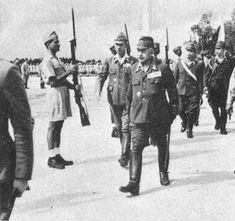 Japanese Army General Kenji Doihara inspecting the troops of the Indian National Army (INA), Singapore, 1944.