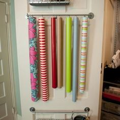 Easy and inexpensive Gift Wrap station on the back of a closet door. Tutorial.