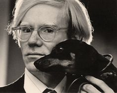 Andy Warhol with his dachshund Archie