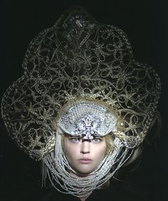 A Russian traditional headdress: this headdress was inspired by Russian traditional headdresses : photography : Karl Lagerfeld for Chanel Paris-Moscow 2009 : thick cloth on a wire frame.