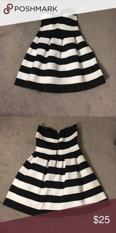 Black and white stressed bandage dress Black and white bandage dress. Zipper in the back, stretchy material. Worn once. Dresses Mini