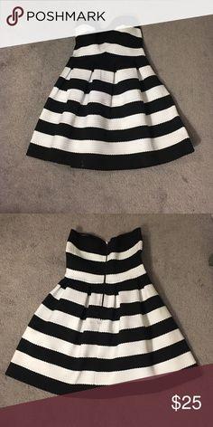 Black and white stressed bandage dress Black and white bandage dress. Zipper in the back, stretchy material. Worn once. Dresses Mini