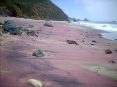 Purple Sand Beaches  The exotic purple sands of the Pfeiffer Beach (near California's Pfeiffer Big Sur State Park) draw their unusual color from manganese garnet granules eroded from deposits littered throughout the area.