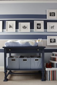 Adorable baby boy's nursery design with blue striped walls with main walls painted Para Paints Oxford, Darkest Blue Stripe - Beyond The Sea, Medium Blue Stripe -Fanfare, Beige Stripe - Cashmere, glossy blue changing table painted Para Paints Convertible and blue bins.   Para PaintsOxford
