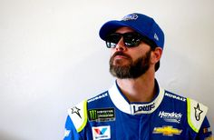 Jimmie Johnson Photos Photos - Jimmie Johnson, driver of the #48 Lowe's Chevrolet, stands in the garage area during practice for the 59th Annual DAYTONA 500 at Daytona International Speedway on February 24, 2017 in Daytona Beach, Florida. - Daytona International Speedway - Day 8
