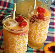 mocktail: 1 part fresh orange juice  1 part ginger ale  5 fresh ripe peaches  (fresh raspberries for garnish)