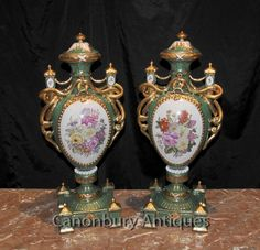 - Gorgeous pair of French Sevres style porcelain floral vases<BR> - Classic pair with bulbous amphora shape and large gilt drape serpent like handles<BR> - Floral spray panel so vivid, ready to add light to any interior<BR> - Surmountable lids and factory stamp on the underside<BR> - Come view in our Canonbury Antiques Hertfordshire showroom, just 25 minutes north of London<BR> - Available to view in the Canonbury Antiques Hertfordshire showroom, just 25 minutes north of London <BR…