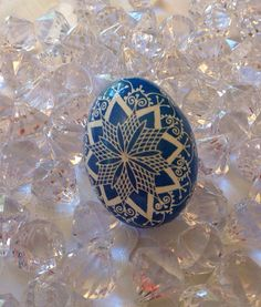 This beautiful traditional Pysanky egg is finished in white and blue. The egg has been dyed using the the traditional Ukrainian batik method. Designs are created by applying dyes in layers using melted beeswax. Upon completion, the egg is covered with a thin layer of clear gloss urethane, blown out and cleaned. Due to differences in computer monitors the colours may appear slightly different in the photographs than on the egg.