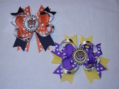 Just a few collegiate hair bows that I have made for an upcoming craft show. These are Auburn and LSU bows.