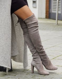 There's something subtly sexy and mysterious about over-the-knee boots.