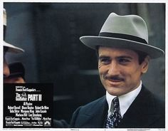 Lobby card for The Godfather Part II (1974), featuring Robert De Niro as Vito Corleone.