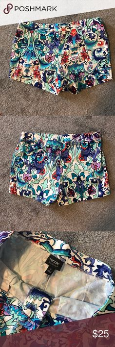 Nicole Miller Floral Patterned Shorts Nicole Miller floral patterned shorts in excellent condition. Bright colors perfect for summer. Size 4. Nicole by Nicole Miller Shorts