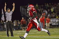 Marysville-Pilchuck's Austin Joyner strolls into the end zone with an easy 18-yard touchdown run to give the Tomahawks a quick 14-0 lead over crosstown rival Marysville Getchell. See more photos from Seattle Times photographer Dean Rutz.