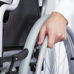 Close-up of hand on wheelchair