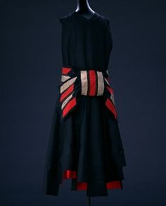 'Bow', to the Master Jeanne Lanvin, Such a Simple Lovely Dress That Comes to Life with the Over-Sized Striped Bow at the Back, Dress of Black Silk Taffeta, Belt of Black Silk Taffeta with Red and Golden Silk Ribbons Appliqué, Paris, 1928.