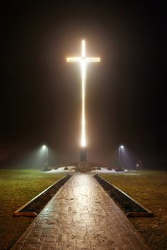 The tallest illuminated, self-supporting cross in the Western Hemisphere stands perched above the city on a foggy night from its location behind St. Basil's Secondary School in Sault Ste. Marie, ON - tfavretto