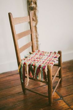 DIY:  Chair Seat Makeover - Great fix for a chair with a broken cane or wicker seat - using strips of scrap fabric, weave to create a seat and tie knots at the end!  Love this, because not everyone knows how to cane, but we all can weave & tie knots:)