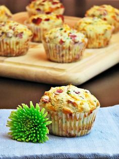 cheese and bacon muffins! They are as delicious as they sound. What you need is: 2 cups all purpose flour 1 tbsp baking powder ¼ cup light brown sugar 1 tsp salt 8-10 slices of turkey bacon (you can use the real stuff too) chopped and crisped 1 cup grated sharp cheddar cheese 1 cup milk 2 eggs 1 stick of butter (melted and cooled) ¼ cup chopped parsley ¼ cup chopped scallions