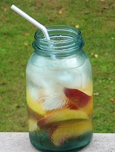 PEACH MOONSHINE MAGIC: Find an old Mason jar to use as a glass.  First, slice a peach into eighths and place in the bottom of the jar.  Then fill the jar 3/4 full of ice.  Add 2oz Georgia Moon Peach Whiskey and 2oz Peach Schnapps and slosh it around in the jar to mix.  Lastly, fill with Sprite, stir, and add a long straw.  #drink #beverage #alcohol #masonjar #peach #whiskey #schnapps
