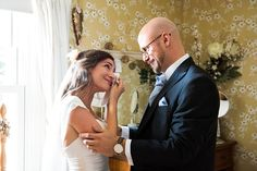 Emotional wedding photography Justin Alexander bride greets Father pre-wedding morning at Busbridge Lakes, Surrey © Fiona Kelly Photography