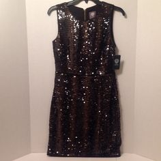 Vince Camuto Sequin Black Coffee Dress - Size 4 This is a gorgeous dress.  If you love sequin dresses you'll love this. Gold Tone zipper.  Style#: VC3A3019.  Dry Clean. Self: 97% Polyester / 3% Elastane. Contrast: 100% Polyester.  Lining: 96% Polyester / 4% Elastane. Made in China.  Happy Poshing! PRICE FIRM Vince Camuto Dresses
